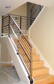 elegant iron handrails for stairs with wooden steps and beige wall for  interior design ideas