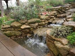 Small Picture natural stone waterfall and stream within this water garden design