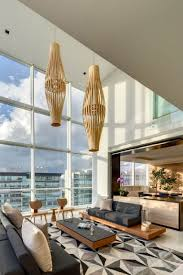 mosaic area rug pattern combined with luxurious mexican house interior set for living room plus a fantastic view through framed glass wall aside