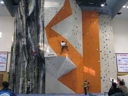 this is an extreme sport in which partints climb up or across an artificial rock wall the goal is to reach the summit of a formation or the end point