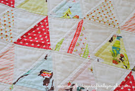Mommy by day Crafter by night: Isosceles Triangle Quilt Along ... & Once you have your quilt sandwich then you are ready to start quilting.  Like I mentioned in my first post, I used my walking foot and straight line  quilted ... Adamdwight.com