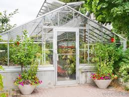 light passes onto the plants in the greenhouse which convert the light into heat energy which is trapped inside the greenhouse by the glass