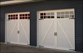 carriage style garage door in white with decorative