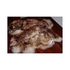 brown white sheepskin rug