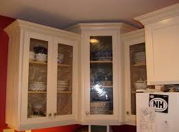 white wooden framed glass door on corner wall cabinet antique