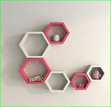 usha furniture pink and white hexagon shape storage wall shelves