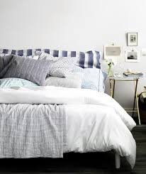 Bed With Blue And White Linens