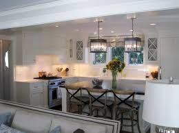 View in gallery Charming kitchen space with green hues and low-hanging  pendant lighting
