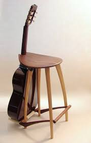 a custom made guitar stand and stool in one