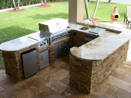 curved stone prefab outdoor kitchens with grey countertop fo