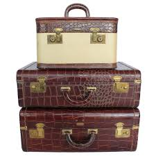 set of 3 vintage leather suitcases for