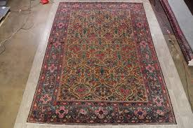 consigned antique oriental hand made persian area rug yellow 15 3 x11 1 traditional area rugs by rugsource inc