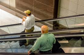 people on escalators. download people on escalators at an airport editorial photography - image: 45420782