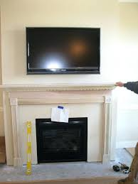 smlf can you hang a flat screen tv over gas fireplace insert and mantle mount panel