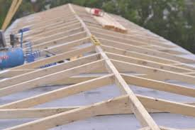 convert my flat roof to a pitched roof