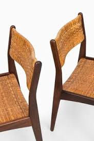 mid century dining chairs in teak and woven cane at studio schalling