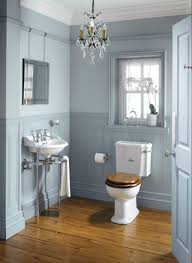 sweet brown toilet seat mixed with grey bathroom wall color and trendy small crystal chandelier