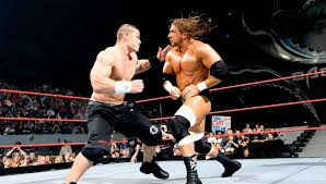 john cena left and triple h in action at 2010 backlash ppv image