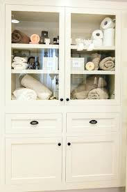 linen cabinets with doors build linen towers cabinets bellacor alfa linen tower with two doors and