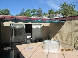 slide wire canopy. Blue Slide Wire Canopy In Backyard