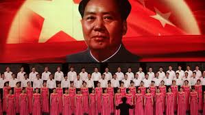 "a petition calls for canceling tribute concerts to ""mass murderer participants sing in front of a screen showing s late chairman mao zedong during a revolutionary"