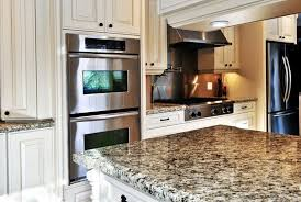 built in double ovens are complimented by a drop in gas range