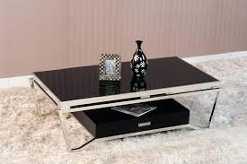 black glass top coffee table black glass top table in rectangular shape which has stainless steel legs and black storage box black frame glass top coffee