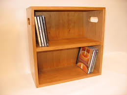 furniture simple brown wooden dvd storage shelves with double racks on the wall entrancing