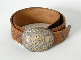 tooled leather belt with sterling trophy buckle
