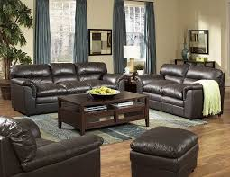 living room handsome living room decor ideas using black leather couches and brown painted wood table storage also blue fabric vertical curtain plus blue