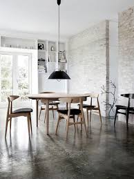 ... Industrial dining room with a fabulous finish for the exposed brick  wall [Design: SUITE