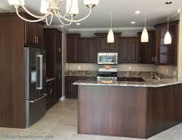peninsula lighting. Kitchen Peninsula With Pendant Lighting Above Ganache Granite Counters. | VillageHomeStores.com