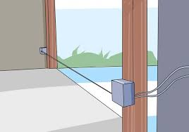 an animated image shows an open garage door with the laser beam between the two photo