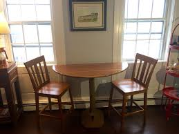 vintage stimpson press high top with chairs