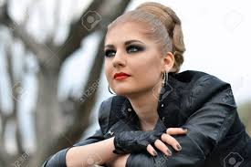 fashionable biker with big green eyes smokey makeup eyes red big lips