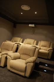 home cinema room chairs. home theatre for a smaller room - nice colour pallet. cinema chairs e
