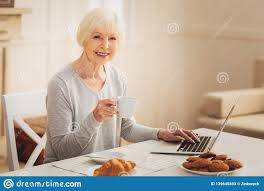 Typing Business Letter Elderly Woman Eating Biscuits While Typing Business Letter