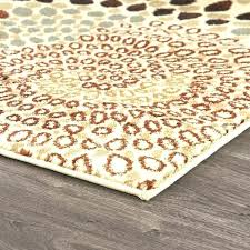 tan swirl area rug by design furniture brown