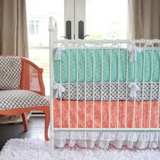 bedroom white steel cradle with tosca and orange also white black bedding placed on the