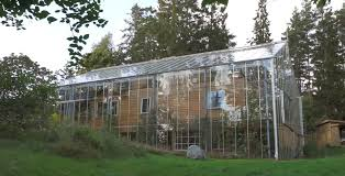 after ing the house the couple decided to surround it with a huge glass greenhouse the construction of tempered glass with a thickness of 4 mm cost