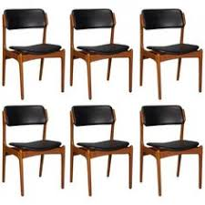 view this item and discover similar dining room chairs at designed in denmark by erik buch for o mobler these chairs feature a teak frame with
