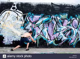 graffiti artist at work on wall in bohemian mauerpark in prenzlauer berg in berlin germany on graffiti artist wall street with graffiti artist at work on wall in bohemian mauerpark in prenzlauer