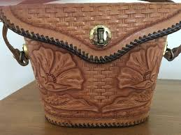 vintage hand tooled leather handbag to expand