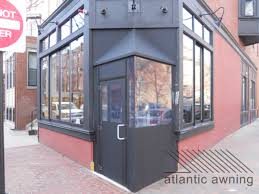 copa restaurant in boston wanted to add a shelter for patrons entering and exiting their elishment but was faced with an unusually small and oddly