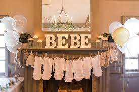 king of the jungle baby shower decorations onesies on clothesline front view