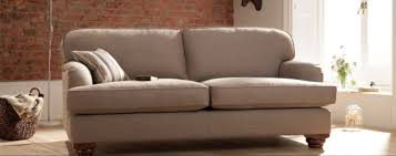 a neutral sofa is a calming feature in a busy room