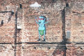 art man graffiti brick wall mural