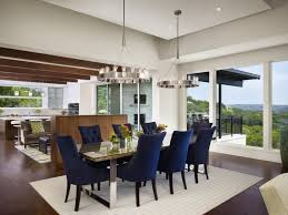 adorable modern house on the hill design glass surface dining table dark blue chairs on