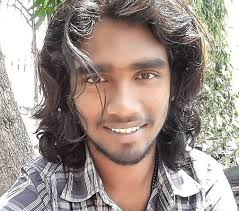 a photograph of an indian male with beautiful long wavy hair reaching his shoulders