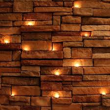 Brick wall lighting Exterior Wall 26 Tea Lights By Eliana Ramage Tealights Against Brick Wall Decoist 26 Tea Lights Compose Journal